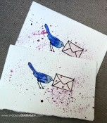 Savvy Stamps Bird with Love Note (retired, similar). Stamped again on Paper Source Luxe Blush and envelope paper pieced and attached. Then painted and splattered with Twinkling H2Os.